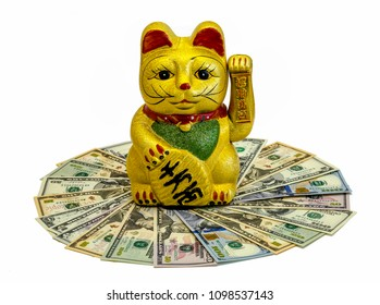 "The Maneki Neko Cat, traditional cultural statue from Japan that is believed to bring great wealth and fortune to it's owner. Fondo aislado en blanco. Translation: ""Come in, please, you are welcome."""