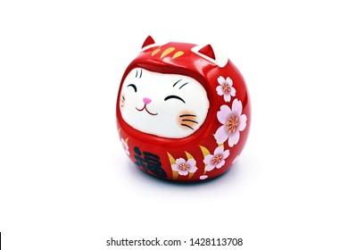 "Maneki Neko Daruma Doll with Japanese word ""Lucky"" , isolated"