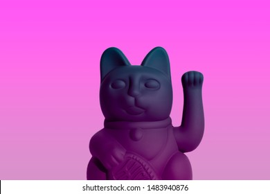 Manekineko with a coin. Good luck plastic matted cat on a pink background. The effect of degradation.