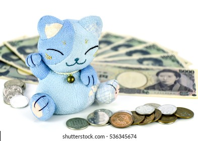 Maneki-neko, the lucky cat and Japanese money.