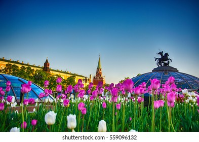 """Manezhnaya Square, the view of Senate and Troitskaya (Trinity) Towers of the Moscow Kremlin and the fountain """"Watch of the World"""", Moscow, Russia"""