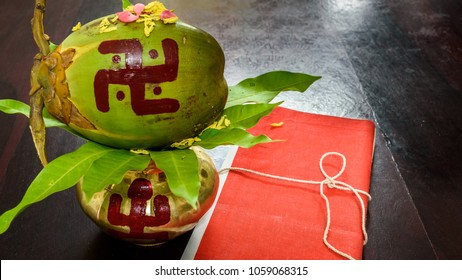 Mangal Kalas With coconut , Flowers And Tree Leafs
