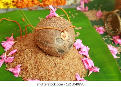 Mangala sutra or thaali on coconut and rice. It is a necklace that the groom ties around the bride's neck in Indian and sub-Indian countries during hindu wedding