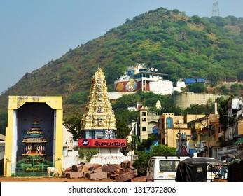 MANGALAGIRI, VIJAYAWADA, ANDHRA PRADESH, INDIA, JANUARY 07, 2019: Street view of Lakshmi Narasimha Swami Mandir, temple chariot and tower gate on the Mangalagiri hill on a bright day.