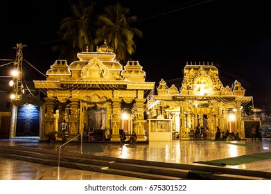 MANGALORE, INDIA - APRIL 15, 2016: Shree Gokarnanatheshwara Temple at night with the golden light shining