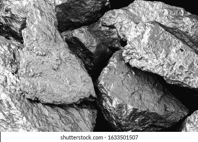 Manganese, manganese, or magnesium stone is a chemical element, it is in the manufacture of metal alloys. Silver colored ore, industrial use. Ore on black isolated background.