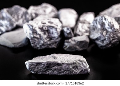 Manganese, manganese or magnesium stone is a chemical element, it is in the manufacture of metal alloys. Silver colored ore, industrial use. Ore on black isolated background.