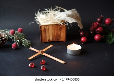 Manger and cross ofJesus Christ. Manger with crown of thorns in stable.  Birth and death of Jesus, Christian Christmas Concept