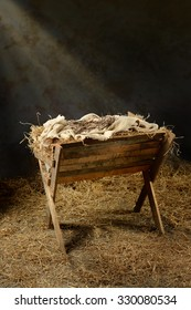 Manger with crown of thorns in barn with light coming from above