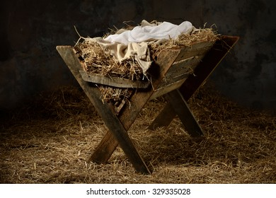 Manger with hay and swaddling clothes in old stable