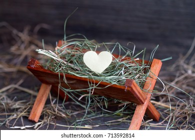 Manger Jesus and the heart of love abstract christmas symbol