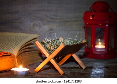 Manger nativity scene lantern and bible in night abstract christmas background