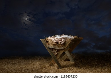 Manger over hay with night sky and moon on background