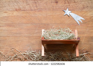 Manger and star of Bethlehem abstracy christmas background nativity scene on wooden board