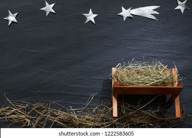 Manger and star of Bethlehem abstracy christmas background nativity scene on black marble