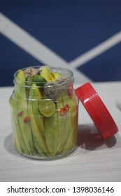 mangga asam boi - a jar of sliced malaysian juicy manggoes served with preserved  fruit plum (a.k.a asam boi) mixed with calaminity lime (a.k.a limau kasturi), chilies and sugar. Loved by everyone.