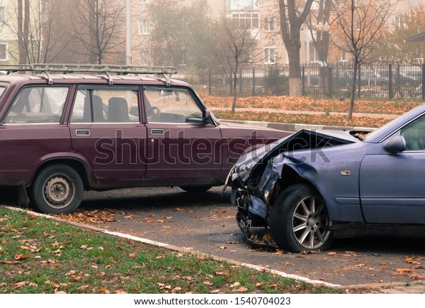mangled-car-after-accident-parking-600w-