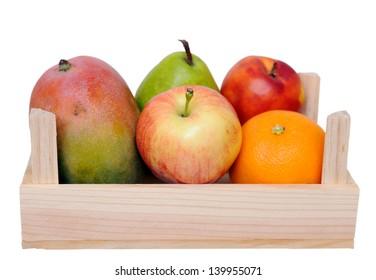 mango, apple, pear, orange, peach in crate isolated on white