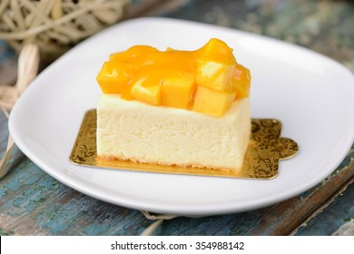 mango cheese cake with white plate background