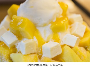 Mango and cube cheese with shaved ice milk flavor serving with syrup