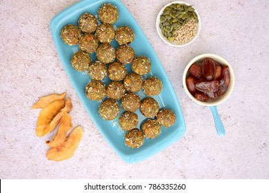 Mango date energy balls with pumpkin and sunflower seeds