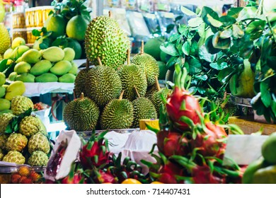 Mango, dragon fruit, durian, custard apples and oranges on a fresh fruit stall at the local market in Ho Chi Minh city (Saigon), Vietnam