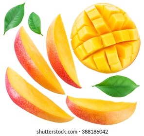 Mango fruit slices and mango leaves over white. File contains clipping paths.