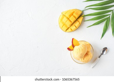 Mango Ice Cream or Sorbet in bowl. Homemade fruit mango ice cream on white background, copy space.