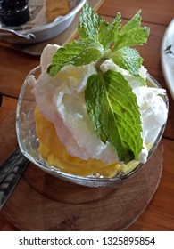Mango ice cream and whipped cream