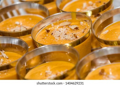 Mango lassi with almond slices on top, overhead view with copy space - Image