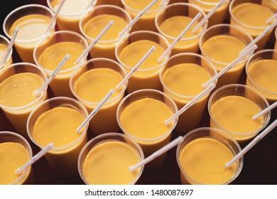 Mango Lassi cups harmoniously arranged