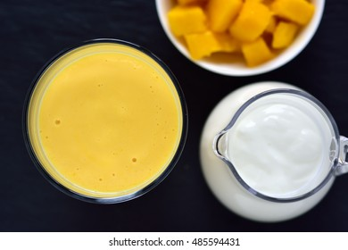 Mango lassi. Mango smoothie made with mango and yoghurt. Selective focus. Top view.
