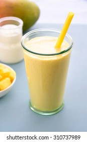 Mango lassi. Mango smoothie made with mango and yogurt, yoghurt. Selective focus.