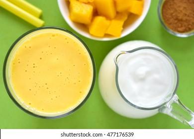 Mango lassi. Mango smoothie made with mango and yogurt. Selective focus. Top view.