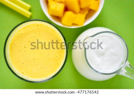 Mango lassi. Mango smoothie made with mango and yogurt. Selective focus. Top view.