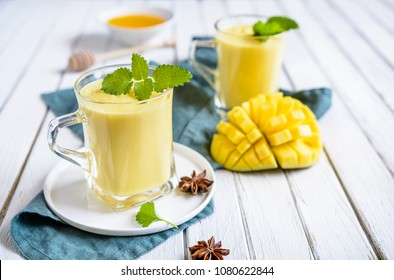 Mango Lassi - traditional Indian yoghurt drink in a glass jars