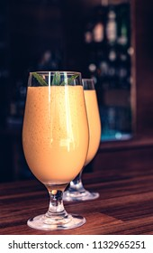 Mango Lassi which is made with mango pulp, yogurts and touch of vanilla ice cream