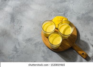 Mango Lassi, yogurt or smoothie. Indian popular summer drink top view