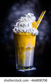 Mango milkshake on rustic background