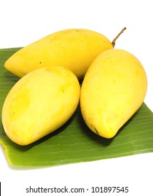 the mango on banana leaf isolated photo