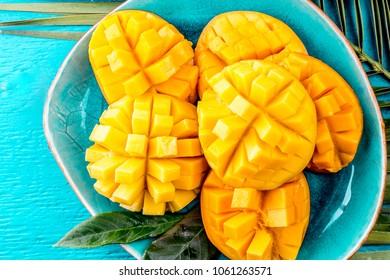 Mango on blue plate.