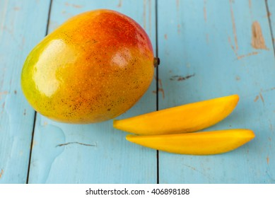 Mango on a blue wooden background