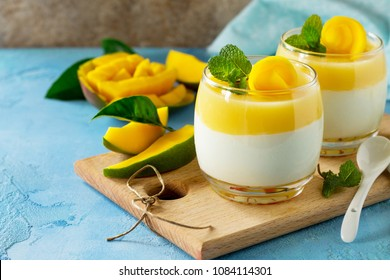 Mango Panna cotta with mango jelly and mint, Italian dessert, homemade cuisine.