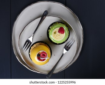 Mango and pistachio cakes, flat lay