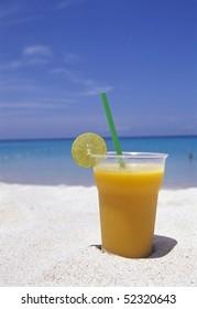mango shake on the beach, selective focus