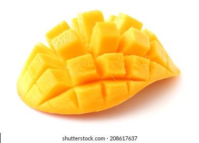 Mango slice cut to cubes close-up isolated on white background