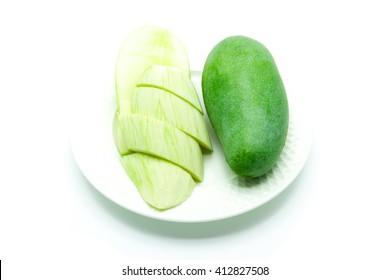 mango with mango slice in dish isolated on white background