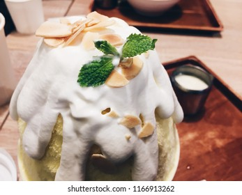 Mango sticky rice kakigori, The shaved ice is drizzled with a slightly salted coconut cream, a mango ice base, more sweet mango cubes, sticky rice at the bottom and topping coconut cream, mango sauce