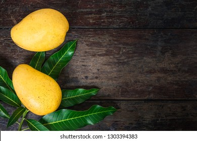 Mango. Tropical Fruits. On a wooden background. Top view.