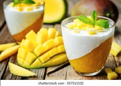 mango vanilla whipped cream dessert on white wood background.toning. selective Focus